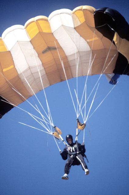 An Army school parachute team member nears the ground during the 1980 Tri-Service Parachute Tournament