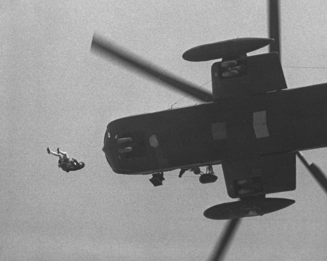 An MGM Grand Hotel fire survivor is reeled into a hovering CH-53 Jolly Green Giant helicopter