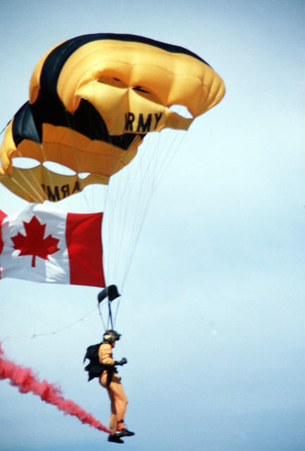 Army Golden Knight parachutist SFC Bernie Polischuk nears the ground during the Armed Forces Day open house demonstration