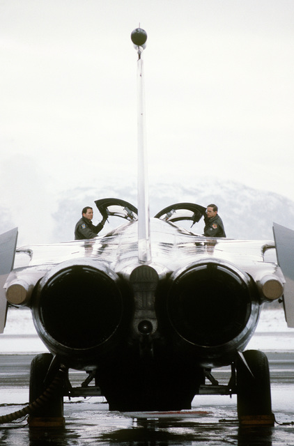 CPT Ron Stanfill, FB-111A aircraft weapons officer, and LTC Ernie Perkins, squadron commander, left to right, make a preflight check of their aircraft during exercise Brim Frost '81. The pilots, simulating aggressors, are assigned to the 391st Tactical Fighter Squadron