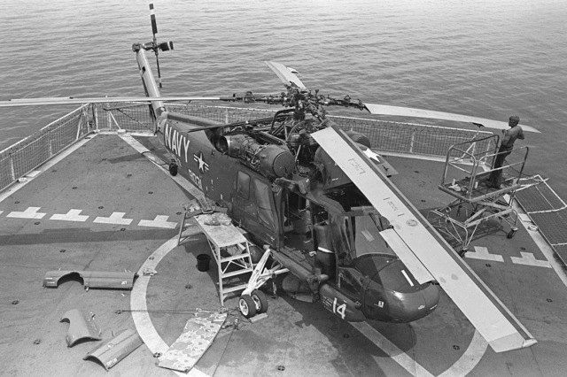 Elevated right front view of an HH-2D Seasprite helicopter from Helicopter Light Antisubmarine Squadron 31 (HSL-31) detachment B, parked on the deck of the surveying ship USNS CHAUVENET (T-AGS 29)