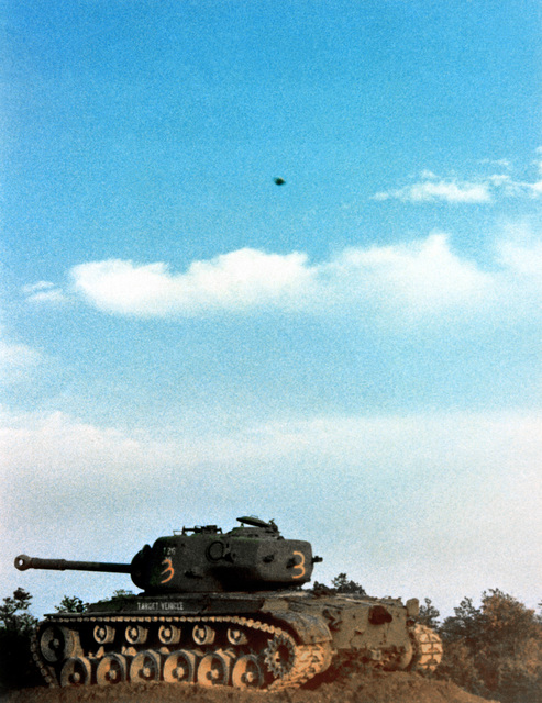 Extended-Range Anti-armor Munition (ERAM) warheads, seconds before impact on an M-48 full-tracked combat tank target, during a validation demonstration test