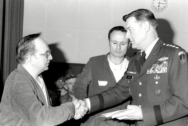 Former hostage Michael Howland is greeted by GEN Frederick Kroesen, commander in chief, U.S. Army Europe and 7th Army. The 52 hostages are spending a few days in the hospital after their release from Iran prior to their departure for the United States