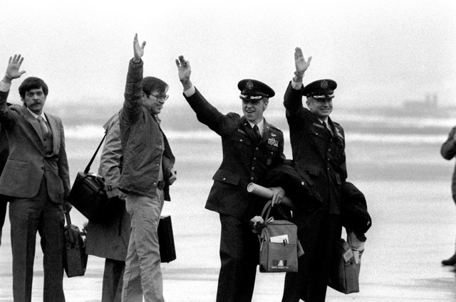 Former hostages Allan B. Golacinski, Clair Barnes, LTC David Roeder and COL Thomas Shaffer, left to right, arrive at the base for their departure to the United States. The 52 hostages were hospitalized for a few days after their release from Iran