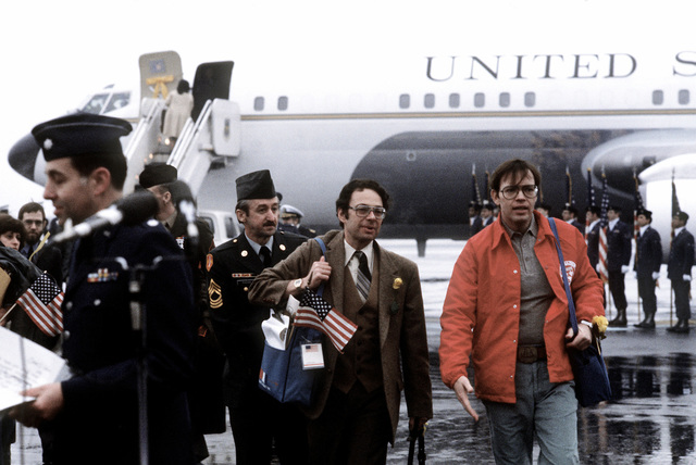 Former hostages Army MSGT Regis Ragan, Sharerand and Clair Barnes, left to right, arrive at the base for their departure to the United States. The 52 hostages were hospitalized for a few days after their release from Iran