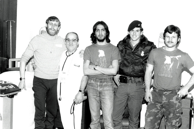 Former hostages U.S. Marine Corps SSGT Michael Moeller and SGT James Lopez, U.S. Air Force SRA Richard Jiran, and U.S. Marine Corps SGT Paul Lewis, left to right, pose with a nurse. The 52 hostages are spending a few days in the hospital after their release from Iran prior to their departure for the United States
