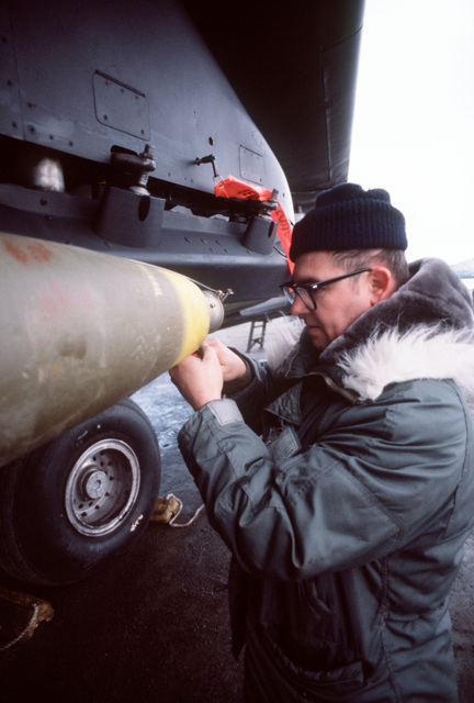 MSGT George Haresky removes safety devices from the M-904 nose fuse of a Mark 82 500-pound laser-guided bombs. The bomb is loaded on an F-111A aircraft for Exercise Brim Frost '81