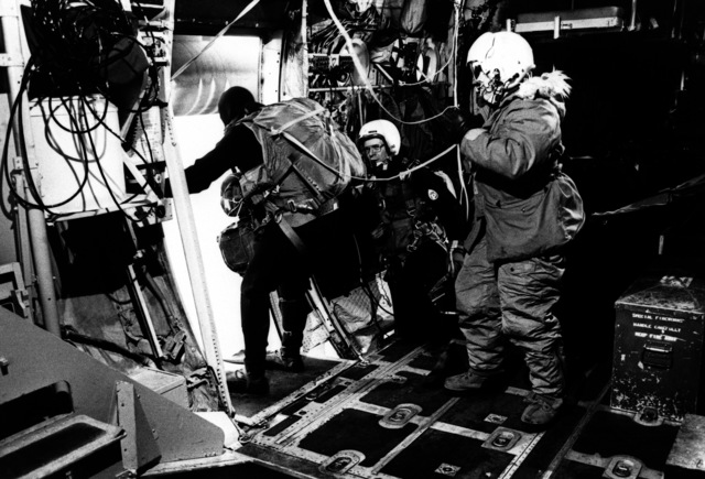 Parachuter SRA Jeffrey Hill prepares to jump off an aircraft into the Pacific Ocean to aid an ailing seaman. Hill is a member of the Air Force Rescue Coordination Center, Aerospace Rescue and Recovery Service