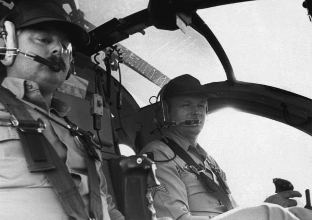 Patrolman Tom Mildren and SGT Harry Christopher, Las Vegas policemen, take part in an air support mission around the blazing MGM Grand Hotel. The crew are members of the Air Support Unit Las Vegas Police Department
