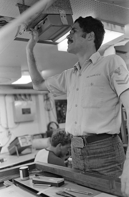 Quartermaster 2nd Class Alan Kennedy uses an intercom aboard the surveying ship USNS CHAUVENET (T-AGS 29)