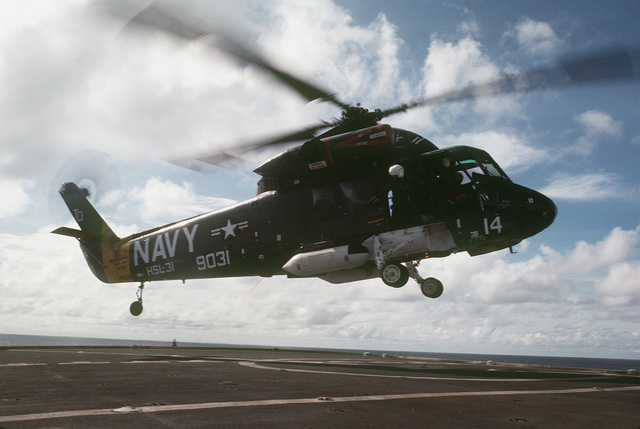 Right side view of an HH-2D Seasprite helicopter from Helicopter Light Antisubmarine Squadon 31 (HSL-31) landing aboard the surveying ship USNS CHAUVENET (T-AGS 29)