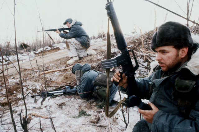 Security police take part in a squad practice search patrol in the defense of a camp base during Exercise Brim Frost '81
