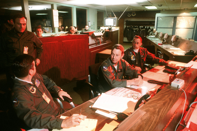 Working in the Elmendorf Operations Center during Exercise Brim Frost '81 are, from left to right: LTC John Borchect, operations officer; COL Robert H. Barger, director of operations, 21st Tactical Fighter Wing and COL George H. Miller, vice commander, 21st Tactical Fighter Wing