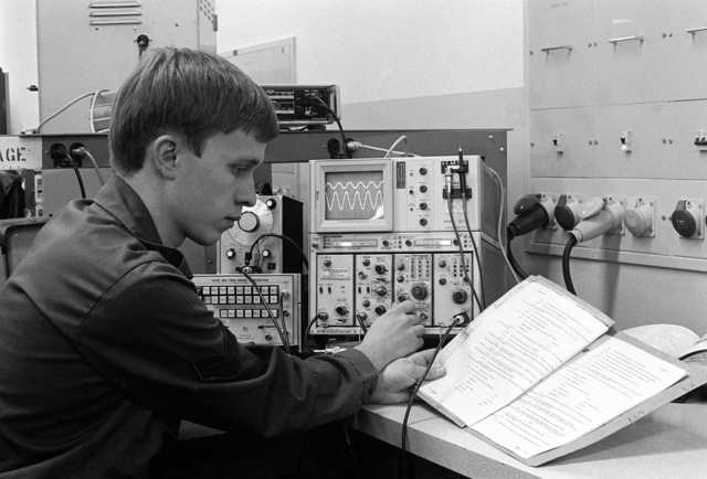 A sergeant checks the accuracy of an oscilloscope