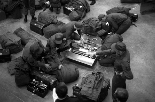 Prime Beef Team members inspect equipment during Strategic Air Command Management Effectiveness Inspection. The team is from the 46th Civil Engineering Squadron, making preparation for deployment