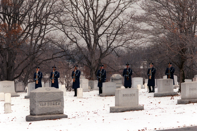 The Air Force Honor Guard fires a 21-gun salute at the conclusion of the graveside funeral service at Arlington National Cemetery for Michael Hammer, AFL-CIO labor specialist in San Salvador for the State Department