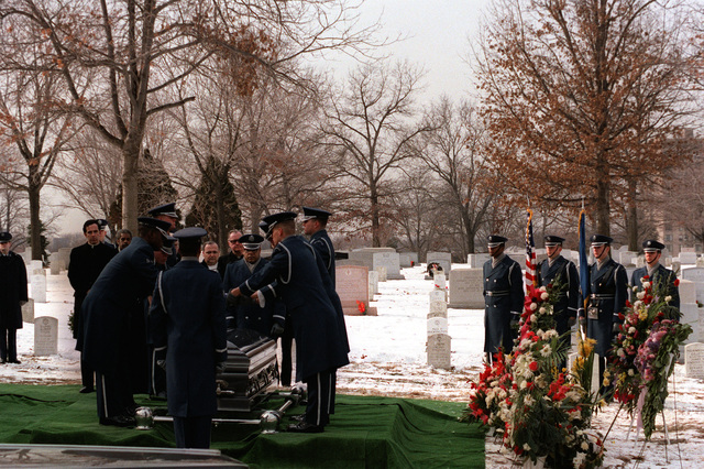 The Air Force Honor Guard folds the flag from the coffin of Michael Hammer, killed in San Salvador while assigned there as AFL-CIO labor specialist for the State Department, during the graveside service at Arlington National Cemetery
