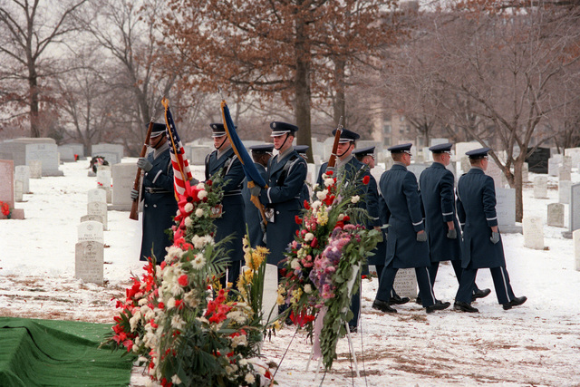 The Air Force Honor Guard takes part in the graveside service at Arlington National Cemetery for Michael Hammer, killed in San Salvador while assigned there as AFL-CIO labor specialist for the State Department