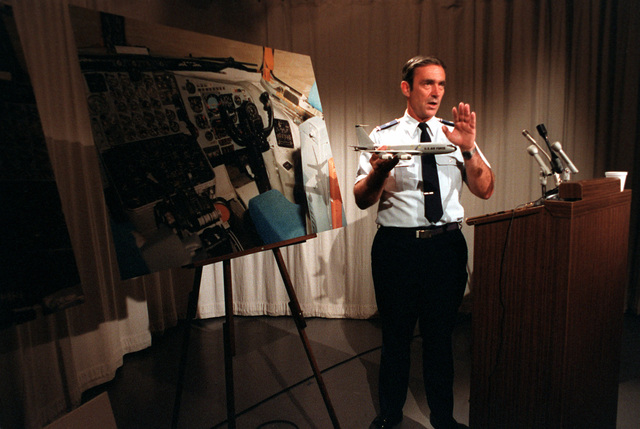 BGEN Peter W. Odgers prepares himself for a press conference on his panel's findings on the crashed EC-135N Stratolifter aircraft