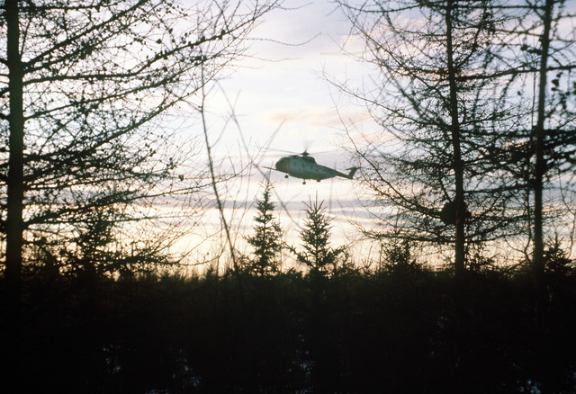 An HH-53 Super Jolly helicopter arrives from Eielson Air Force Base, Alaska, with supplies during exercise Brim Frost