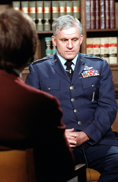 MGEN Kelly Burke, deputy chief of staff, Research and Development, Headquarters, U.S. Air Force, is interviewed by a reporter at the Pentagon