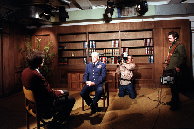 MGEN Kelly Burke, deputy chief of staff, Research and Development, Headquarters, U.S. Air Force, is interviewed and photographed by media representatives at the Pentagon