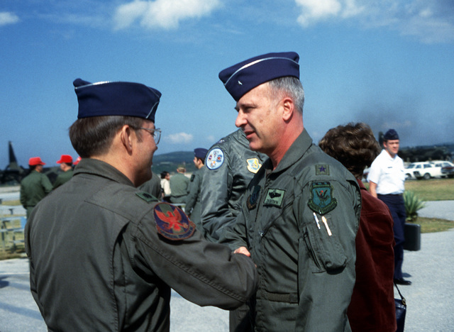 BGEN Brown (right), bids farewell to LTC R. Turczynski, 1ST Special Operations Squadron commander, as he prepares to leave for Clark Air Base, Philippines