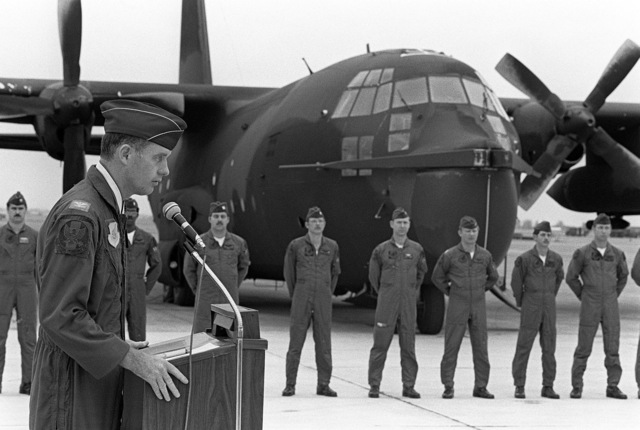 COL Thomas G. McInerney, commander, 3rd Tactical Fighter Wing, gives a welcoming speech as members of the 1ST Special Operations Squadron listen. The men are standing in front of their MC-130E Hercules aircraft. The squadron has just transferred from Kadena Air Base, Japan, to Clark Air Base