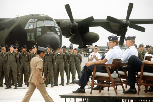 Commander of the Philippine Air Force COL Ricardo T. Madaba walks to his seat after welcoming members of the 1ST Special Operations Squadron. The men, standing in front of their MC-130E Hercules aircraft, have just transferred from Kadena Air Base, Japan