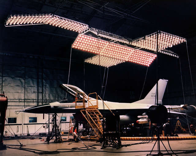 Left side view of an F-16 Fighting Falcon aircraft undergoing climatic testing at the Armament Development and Test Center McKinley Laboratory