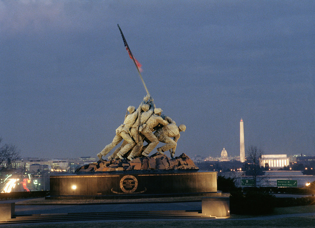A night scene of the Marine Corps War Memorial with the Lincoln Memorial, the Washington Monument and U.S. Capitol in the background