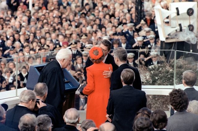 After Ronald Reagan takes the oath of office as the 40th president of the United States his wife Nancy, gives him a kiss during the Inauguration Day celebration