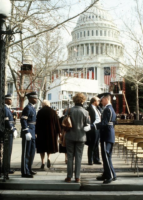 Air Force Presidential Honor Guard members A1C Milton Flowers (left), and Shaun Squyers usher spectators to their seats, prior to the swearing-in ceremony for President Ronald Reagan