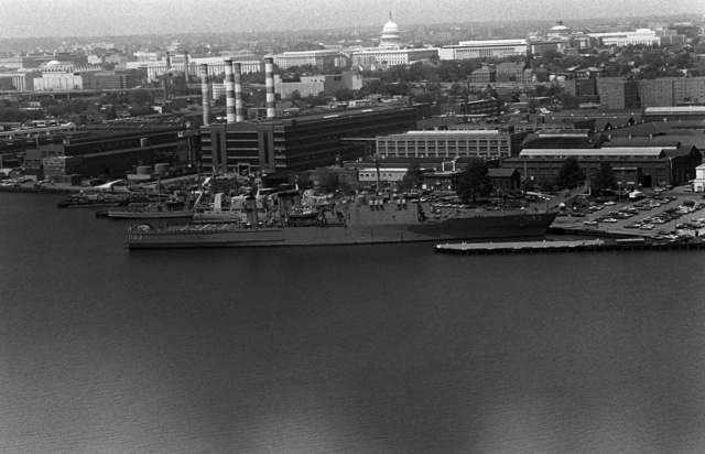 An aerial starboard beam view of the tank landing ship USS FAIRFAX COUNTY (LST 1193) docked at the Washington Navy Yard
