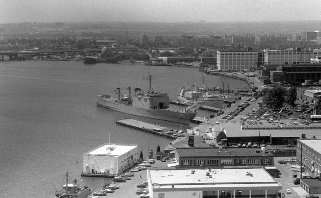 An aerial starboard bow view of the tank landing ship USS FAIRFAX COUNTY (LST 1193) docked at the Washington Navy Yard
