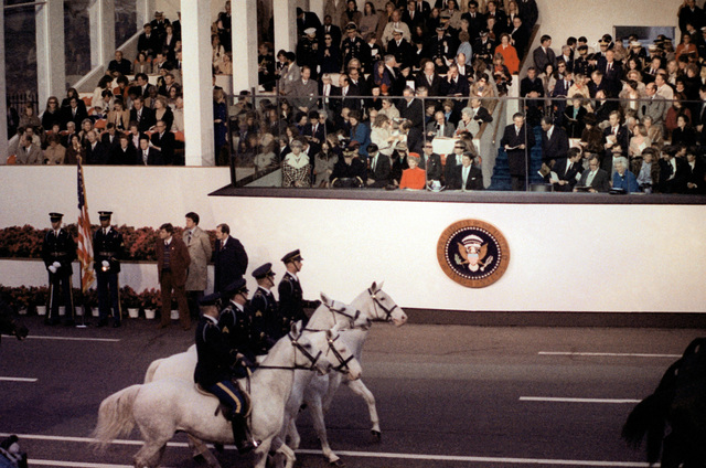 Four horsemen from the 3rd Infantry Division (The Old Guard), Fort Myer, Va., pass the presidential reviewing stand on Inauguration Day
