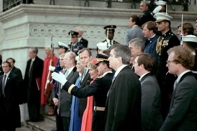 GEN Edward C. Meyer, U.S. Army chief of staff, describes one of the Army marching units in the Inaugural parade to president Ronald W. Reagan and Vice President George Bush. Standing behind the president on the steps of the U.S. Capitol is LTC Jerry Stewart, aide to Vice President Bush