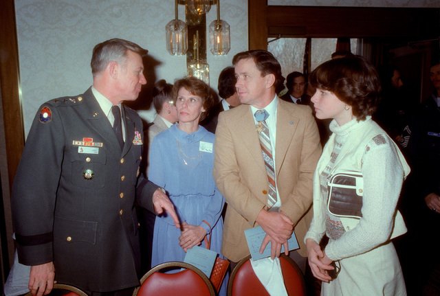 LGEN Robert Gard talks with COL Pat Brady, U.S. Army, Medal of Honor recipient in January 1968, during a special dinner held in honor of Medal of Honor recipients on Inauguration Day