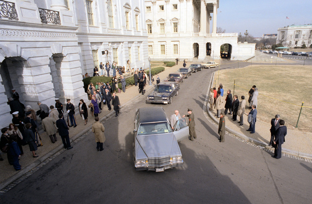 Limousines and people line the outside of the Capitol, prior to the appearance of President Ronald Reagan, and the start of the motorcade during the Inauguration Day celebration