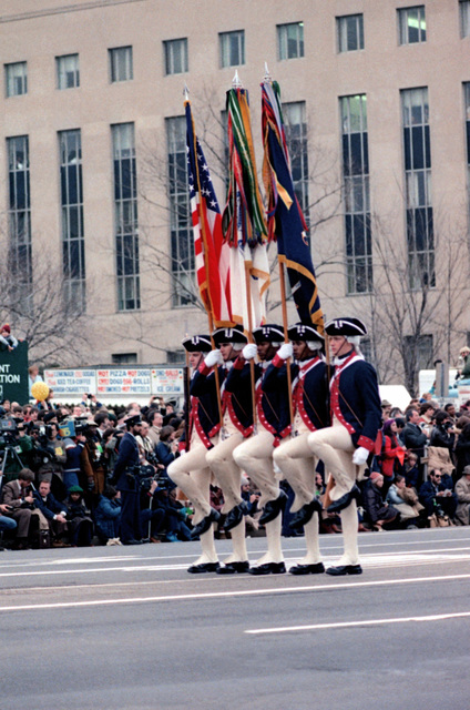 Members of the color guard of the 3rd Infantry Division (The Old Guard), Fort Myer, Va., dressed in colonial uniforms, march past the presidential reviewing stand on Inauguration Day