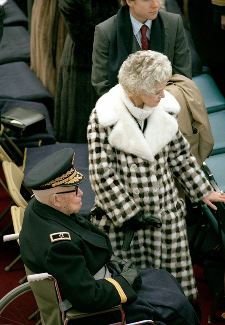 Mrs. Omar Bradley stands beside her husband, retired AGEN Omar Bradley. AGEN and Mrs. Bradley are in the presidential reviewing stands during the Inauguration Day Parade