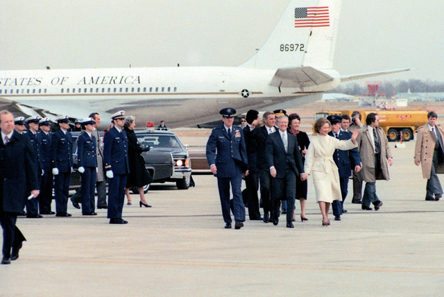 President James E. Carter and Vice-President Walter Mondale walk with their wives and aides at Andrews Air Force Base
