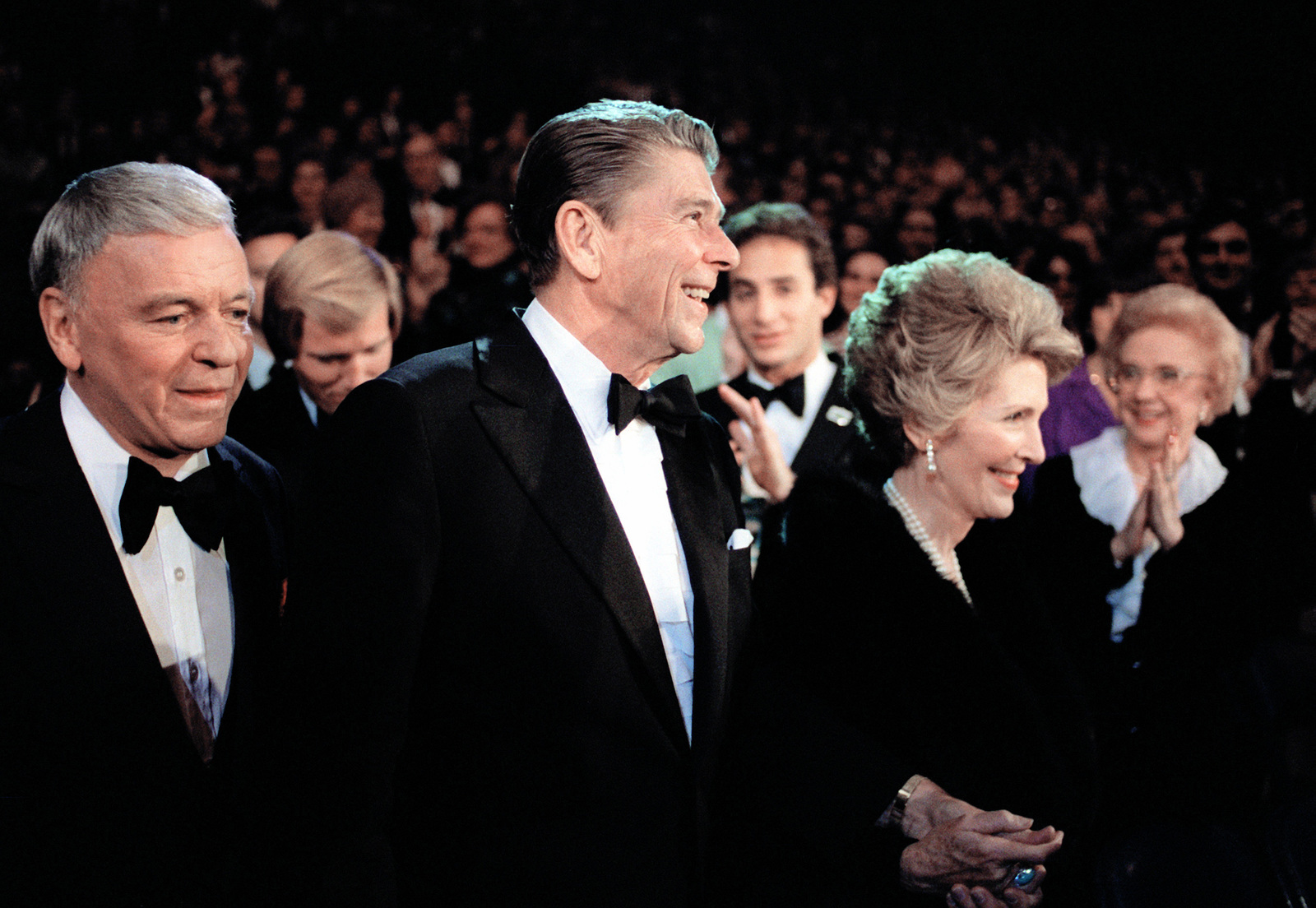 President Ronald W. Reagan and his wife are hand in hand as they say hello to their friends and guests during their gala celebration at the Capital Center, during Inauguration Day. To the President's right is the entertainer Frank Sinatra