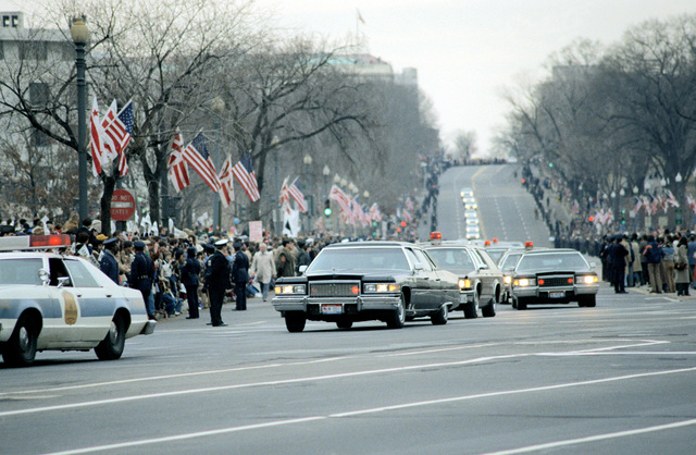 The presidential motorcade winds its way down Independence Ave. from the Capitol to the White House during the Inauguration Day parade