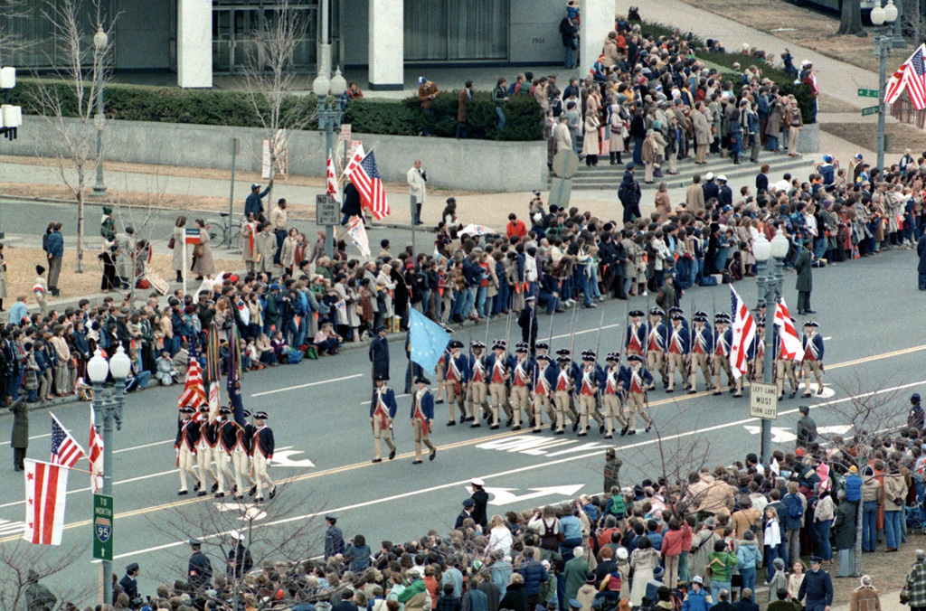 U. S. Army personnel from the 3rd Infantry Division (The Old Guard), Fort Myer, Va., dressed in colonial uniforms, march down Pennsylvania Avenue during the Inauguration Day parade