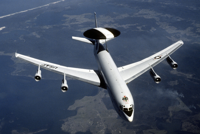 A top view of an E-3A Sentry airborne warning and control system (AWACS) aircraft in flight