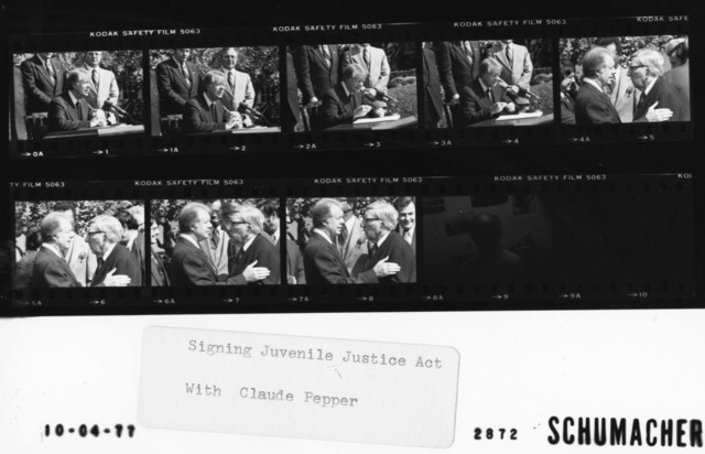 Signing Juvenile Justice Act with Claude Pepper