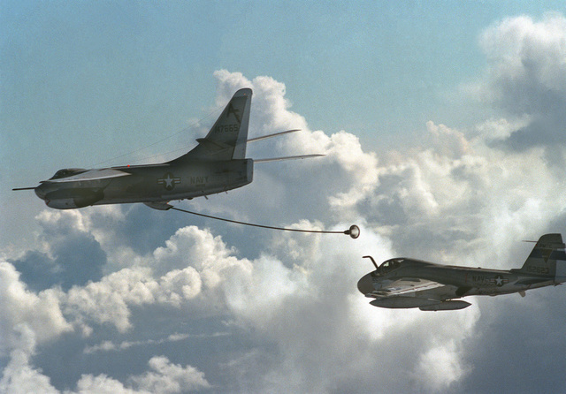 Air-to-air view of an A-3 Skywarrior aircraft preparing to refuel an A-6 Intruder aircraft, rear