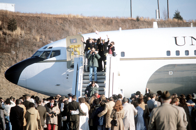 Families wait for the former hostages to disembark the plane. The former hostages will be on U.S. soil for the first time since their release from Iran