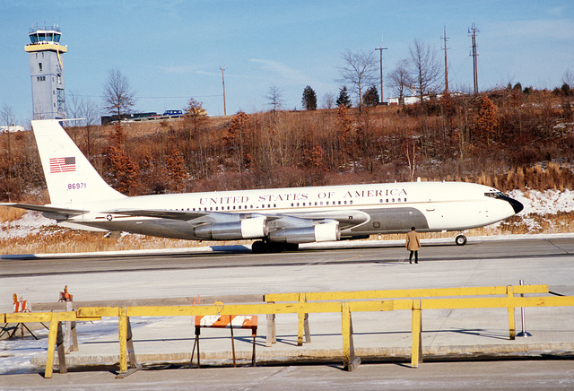Right side view of the VC-137 aircraft (parked) with former hostages from Iran aboard
